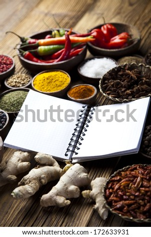 Cookbook and various spices - stock photo
