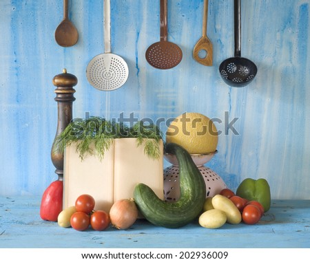 cookbook, vegetables,old kitchen utensils, free copy space - stock photo