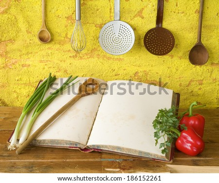 cookbook with free copy space, vintage kitchen utensils, vegetables - stock photo