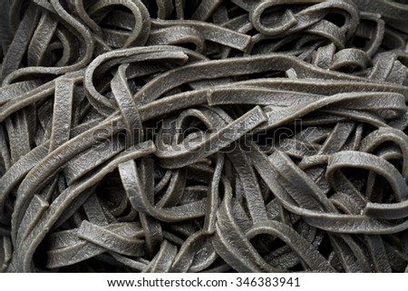 cooked black noodles with squid sepia ink - stock photo