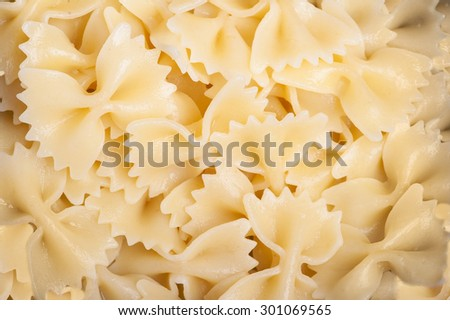 Cooked bow tie pasta noodles closeup macro - stock photo