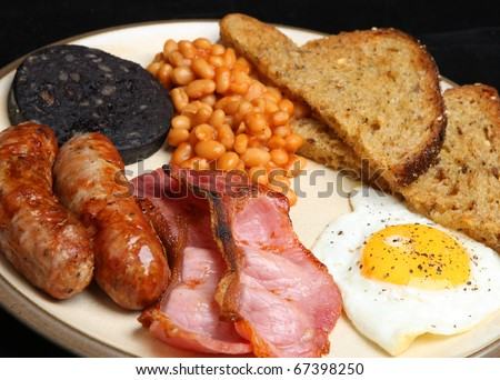 Cooked breakfast with black pudding, baked beans and fried bread. - stock photo