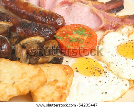 Cooked breakfast with hash browns, - stock photo