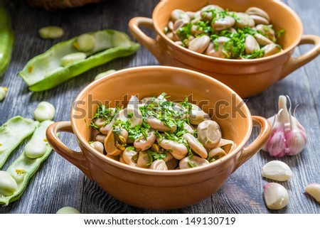 Cooked broad beans with parsley - stock photo