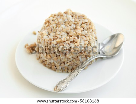Cooked buckwheat on the plate - stock photo
