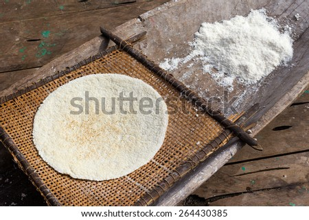 Cooked cassava pie and grinded root, indigenous cooking style - stock photo