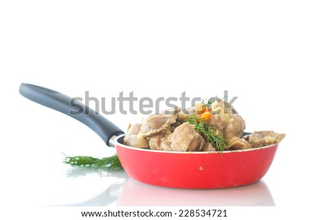cooked chicken gizzards with vegetables and sauce - stock photo