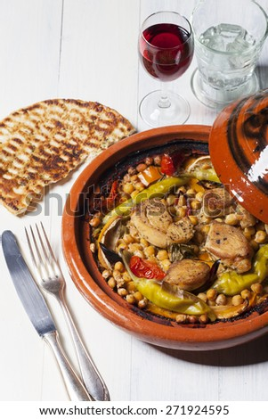 cooked chicken in a tajine  - stock photo