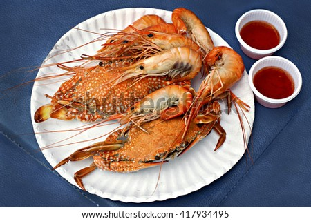 Cooked crab and shrimp on a plate - stock photo