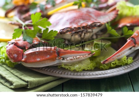 Cooked crab with lettuce and lemons - stock photo