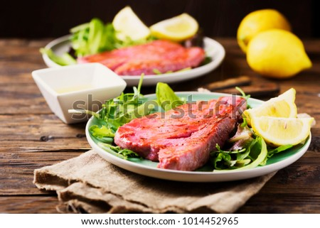 Cooked delicious tuna fish with green salad, selective focus