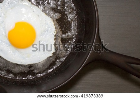 Cooked Duck Egg in Cast iron Skillet - stock photo