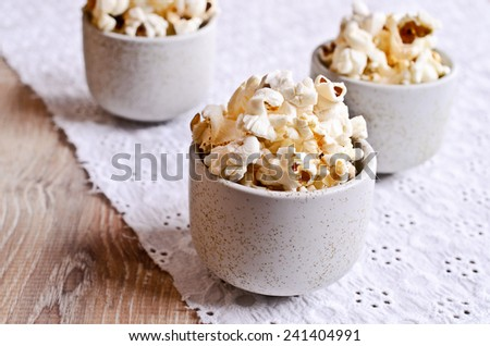 Cooked grains of popcorn ready for consumption - stock photo
