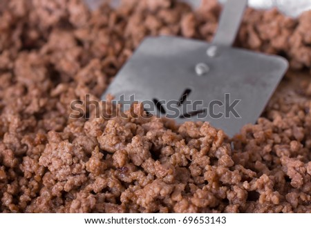 Cooked ground beef and a spatula in preparation for a meal - stock photo