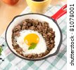 Cooked Ground Beef with Fried Egg in Middle, Served with Strawberries and Tea - stock photo