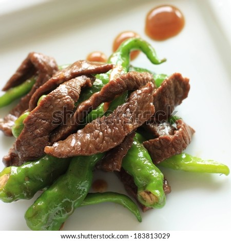 Cooked meat and vegetables on a white plate. - stock photo