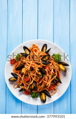 Cooked mussels and pasta - stock photo