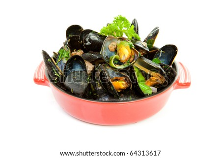 cooked mussels in red casserole over white background