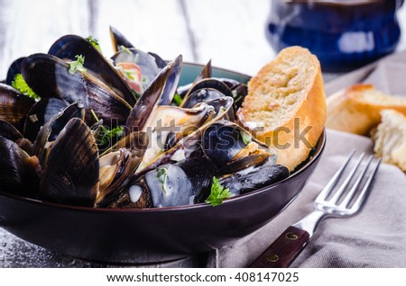 Cooked mussels with cream sauce, close up