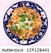 Cooked oriental risotto, meat with rice closeup - stock photo