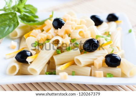 Cooked pasta with cheese and vegetables, close up - stock photo