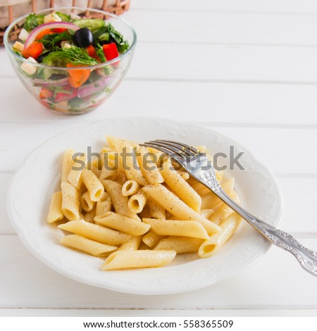 Cooked penne with useful vegetables