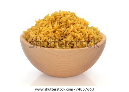 Cooked pilau spiced rice in a beech wood bowl, over white background. - stock photo