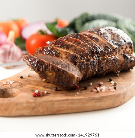 Cooked Pork Loin Roast with Vegetables and Spices - stock photo