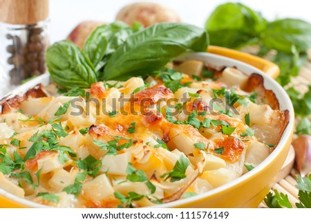 Cooked potatoes with brown crust - stock photo