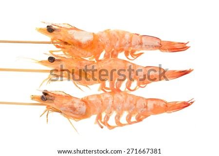 Cooked Prawns On bamboo Skewers - stock photo