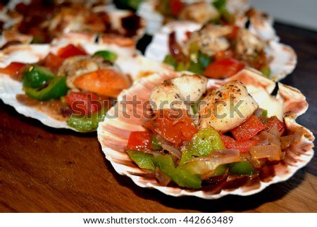 Cooked queen scallops in sea food dinner concept - stock photo