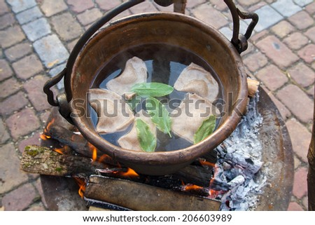cooked ravioli with ancient methods cereals emmer wheat and barley ancient crafts historic medieval festival - stock photo