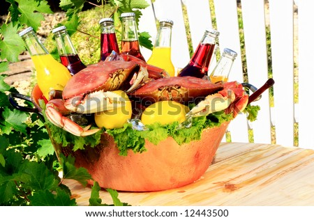Cooked Red Dungeness Crabs In Copper Bucket With Assorted Flavored Pop or Sodas, Orange, Cranberry, Lemon, Berry - stock photo