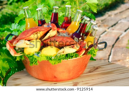 Cooked Red Dungeness Crabs In Copper Bucket With Assorted Flavored Sodas, Orange, Cranberry, Lemon, Berry, - stock photo