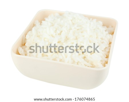 Cooked rice in bowl isolated on white