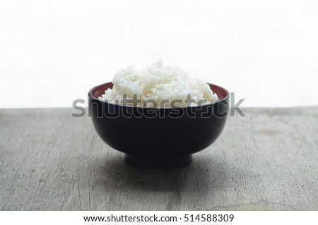 Cooked rice in bowl  on old wooden table