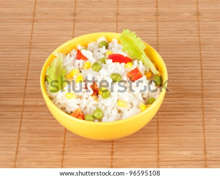 cooked rice in bowl with vegetables - stock photo