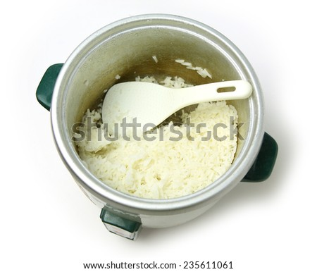 Cooked Rice in electric pot - stock photo