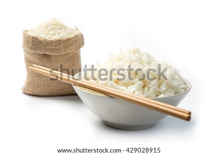 Cooked rice with chopsticks  isolated on a white background with shadow - stock photo