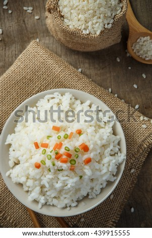 Cooked rice with chopsticks on a sack - stock photo