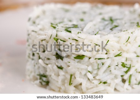 Cooked rice with herbs - stock photo
