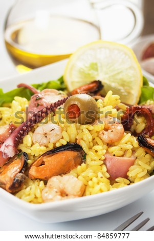Cooked rice with seafood, classic risotto in white bowl - stock photo