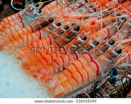 Cooked Scampi Prawn at Seafood Market - stock photo