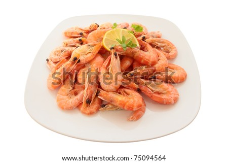 Cooked shrimp on a large plate. Isolated on white - stock photo