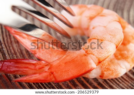 Cooked shrimps with fork closeup on glass plate , shallow dof - stock photo