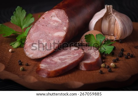cooked smoked sausage on the cutting board - stock photo