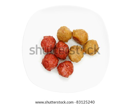 cooked specialty gourmet food . meat balls and chicken balls on white plate isolated . - stock photo