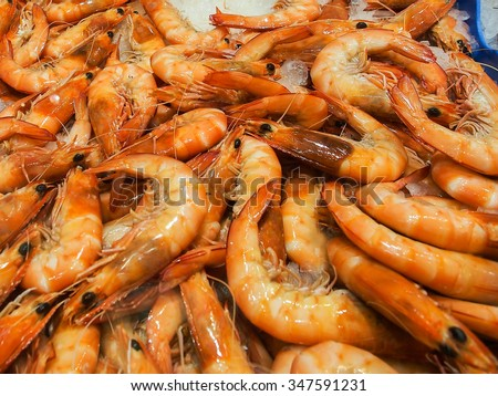 Cooked Tiger Prawn on Ice at Sydney Seafood Market - stock photo