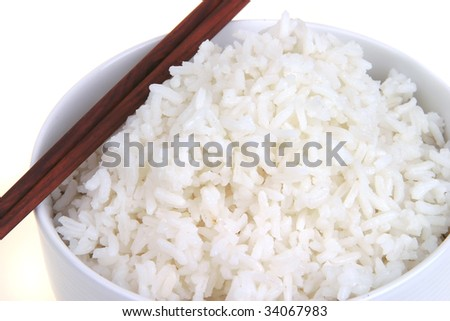 cooked white boiled rice in big white bowl - stock photo