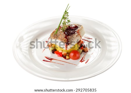 Cooked white fish fillet with colorful salad isolated on white background - stock photo
